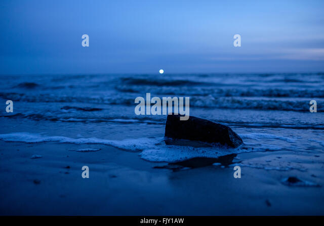 Scenic View Of Sea Against Blue Sky At Dusk - Stock Image