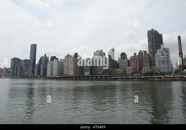 Manhattan Skyline and East River as Seen From Roosevelt Island New York City USA Copy Space - Stock Image