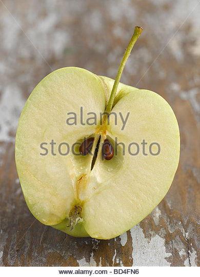 Half an apple (Golden Delicious) - Stock Image