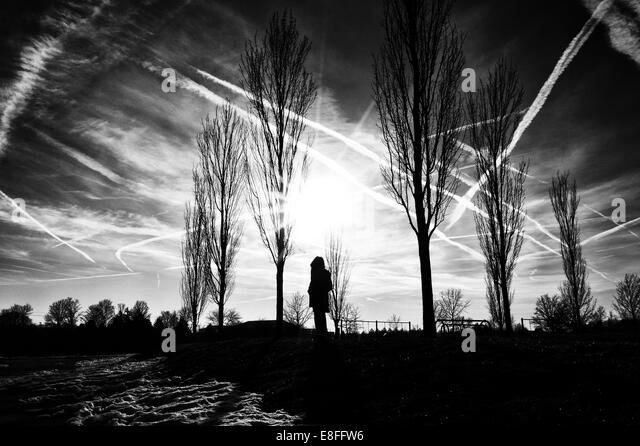 USA, Indiana, Hamilton County, Fishers, Silhouette of person standing outdoors - Stock Image