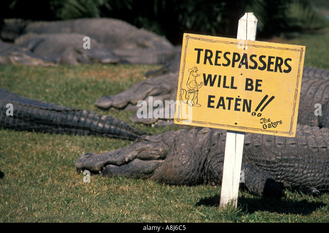 Orlando Kissimmee FL Gatorland sign warning Trespassers Will Be Eaten - Stock Image