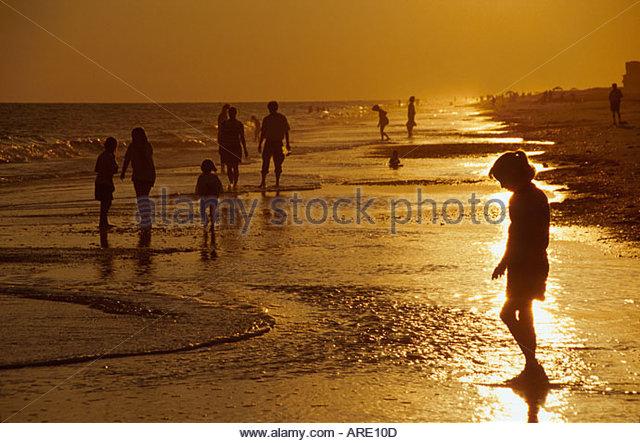 Alabama Gulf Coast Gulf Shores shell hunters beachcombers sunset - Stock Image