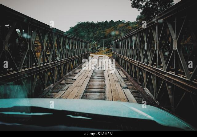 Crossing the wooden bridge - Stock-Bilder
