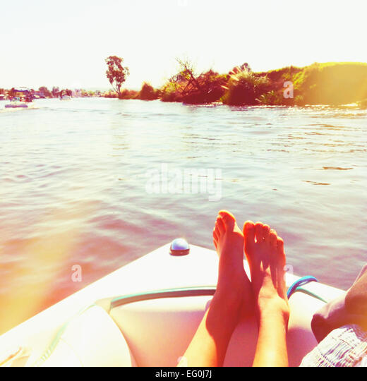 Woman relaxing on a sailing boat, California, America, USA - Stock Image