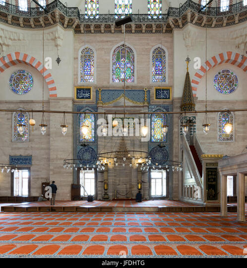 Istanbul, Turkey - April 19, 2017: Few people praying at Suleymaniye Mosque, an Ottoman imperial mosque built in - Stock Image