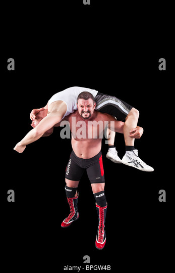 wrestler with man on shoulders - Stock Image