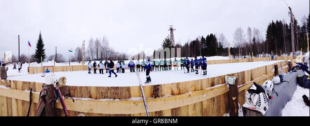 Panoramic View Of People Playing Ice Hockey Against Clear Sky - Stock Image