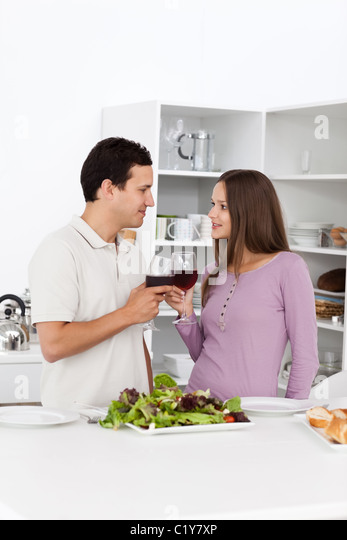 Young couple giving a toast during the lunch - Stock-Bilder