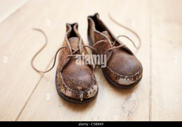 Pair of handmade child's shoes - Stock Image