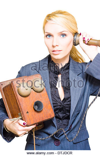Professional And Corporate Blond Female Business Phone Operator Holding A Retro Telephone In Past Era Image Of Communication - Stock Image