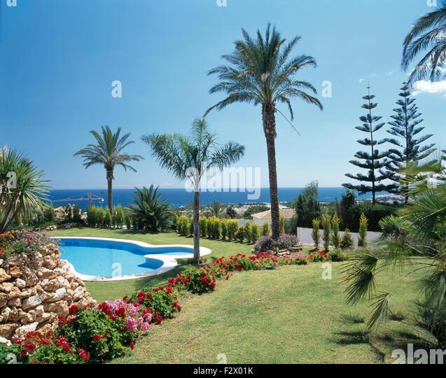 Well tended garden stock photos well tended garden stock for Palm tree villas 1