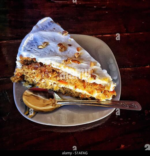 A piece of carrot cake is beautifully presented in a restaurant in Lo de Marcos, Nayarit. - Stock-Bilder