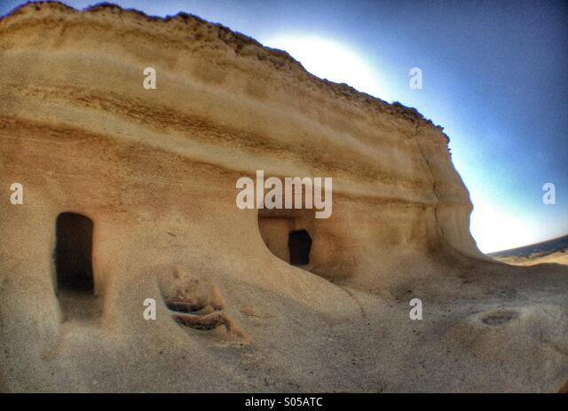 Fishermen's hut carved into cliff - Stock Image