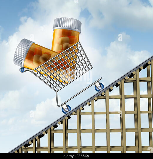 Rising medicine costs and the increase in drug insurance prices as prescription pill bottles in a shopping cart - Stock Image