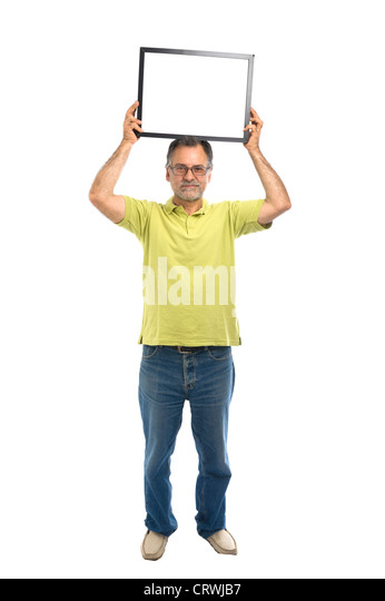 Middle-aged man holding a blank picture frame - Stock Image