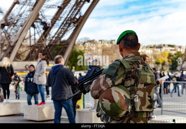 Vigipirate soldier monitoring Eiffel Tower in Paris, France - Stock Image