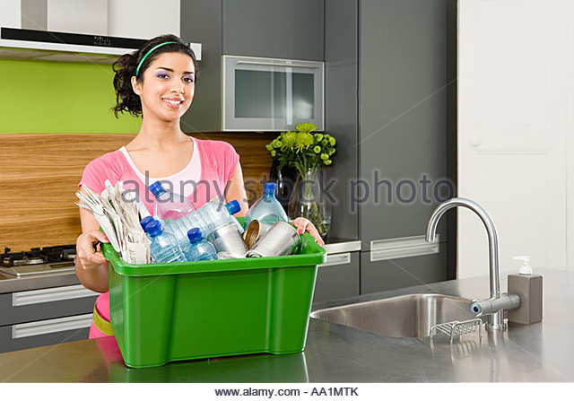 Woman holding box of recycling - Stock Image