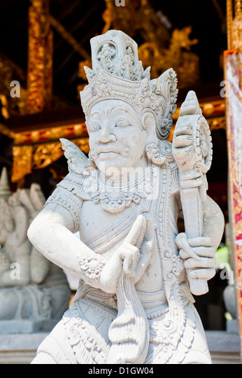 Hindu stone statue at Pura Tirta Empul Temple, a Hindu Temple on Bali, Indonesia, Southeast Asia, Asia - Stock Image