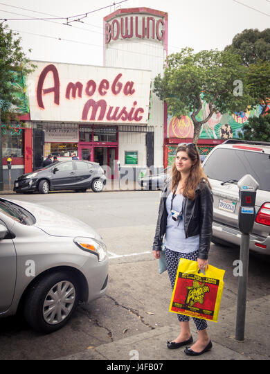 A music fan outside of the Amoeba Music (Amoeba Records) store on Haight Street in the Haight-Ashbury district of - Stock Image