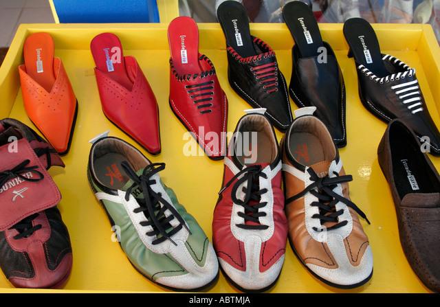 Saint Martin Marigot French Port la Royale shoe display for sale - Stock Image