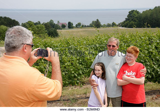 Michigan Traverse City Old Mission Peninsula Two Lads vineyard winery East Arm Grand Traverse Bay man men boy. girl - Stock Image