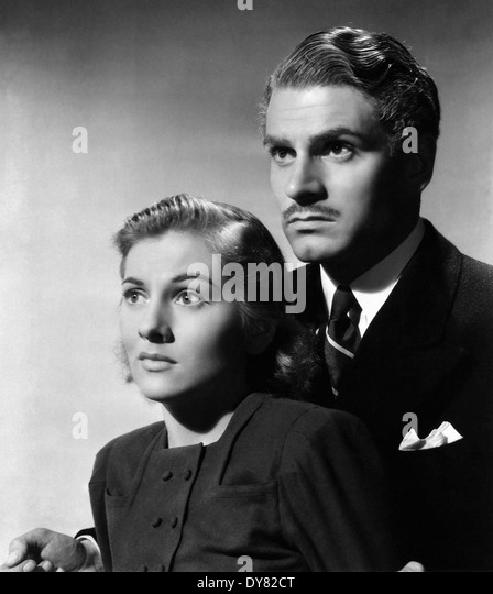 Rebecca - Laurence Olivier, Joan Fontaine - Directed by Alfred Hitchcock - United Artists - 1940 - Stock Image