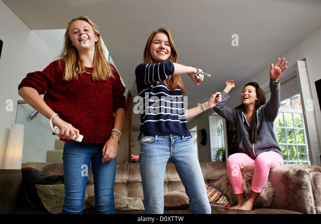 Teenage girls playing video game - Stock Image