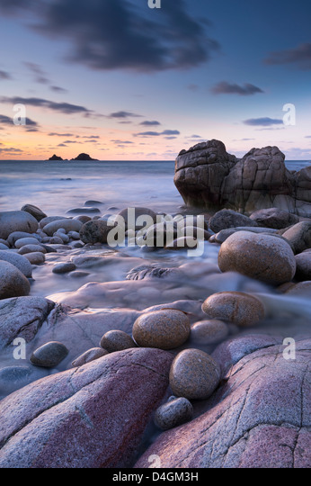Twilight on the rocky Cornish cove at Porth Nanven, Cornwall, England. Winter (December) 2012. - Stock Image