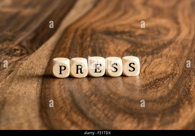 PRESS word background on wood blocks - Stock Image