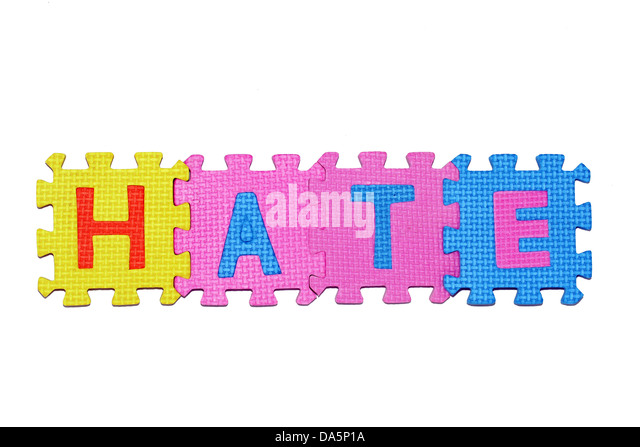 Word Hate from letter puzzle, isolated on white background. - Stock Image