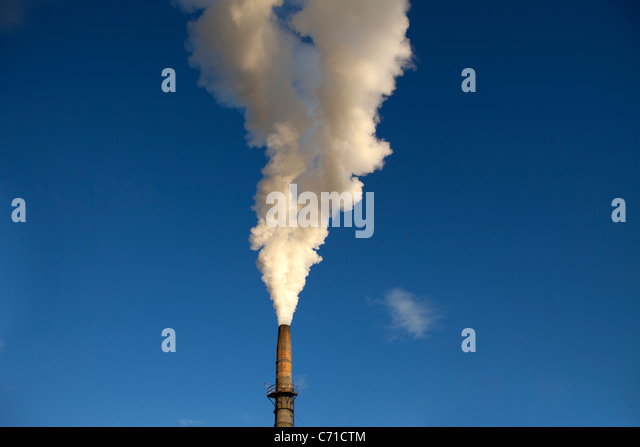 Pipe at mill with lots of smoke. - Stock Image