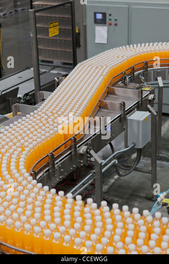 Production line in a bottling factory - Stock Image