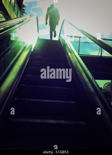 Man at the end of metal stairs. - Stock-Bilder