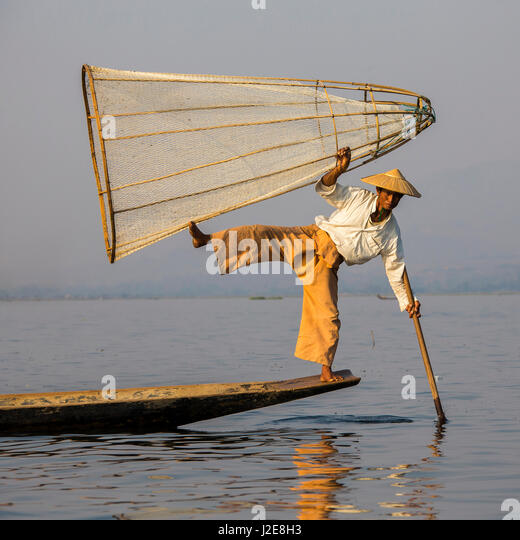 Leg rowing style, Intha fishermen on Inle Lake, Myanmar - Stock Image
