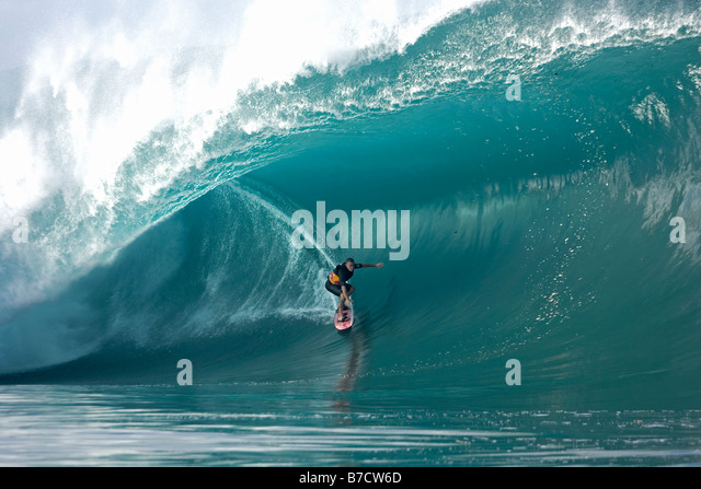 Jamie Sterling surfing at Teahupoo Tahiti - Stock Image