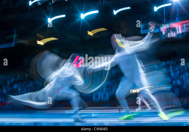 Blurred action of fencing competition. - Stock Image