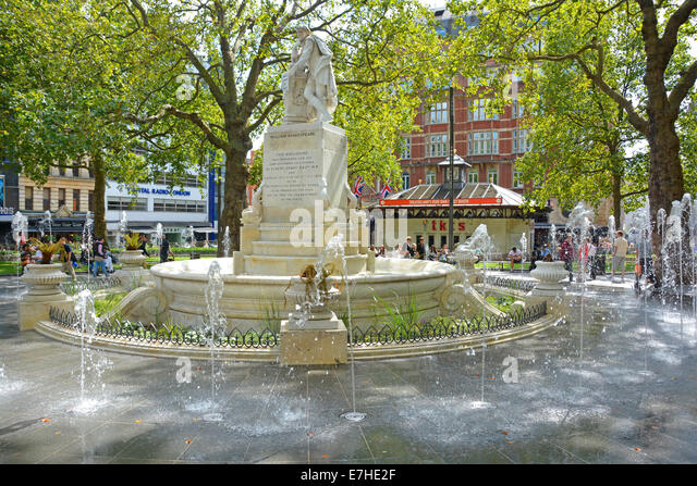 Leicester Square fountains and William Shakespeare statue in the refurbished gardens - Stock Image