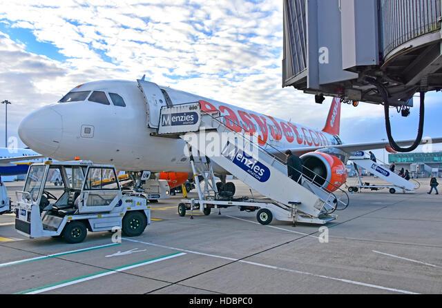 Stansted Airport London, passengers Menzies Aviation boarding steps walk EasyJet airplane unused jet bridge plane - Stock Image