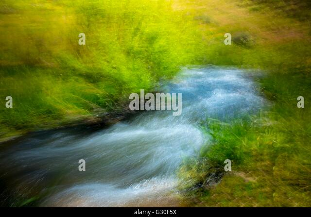 Impressionist style photograph of a stream - Stock Image