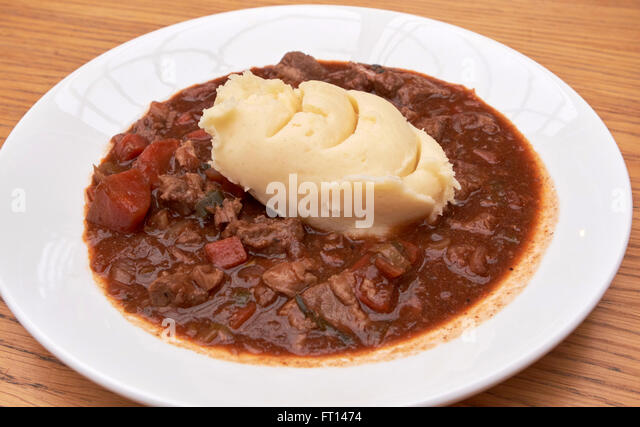 plate of beef and guinness irish stew topped with mash potato dublin Ireland - Stock Image