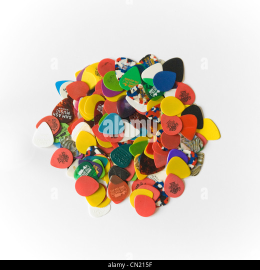 Pile of Guitar Picks on White Background - Stock Image