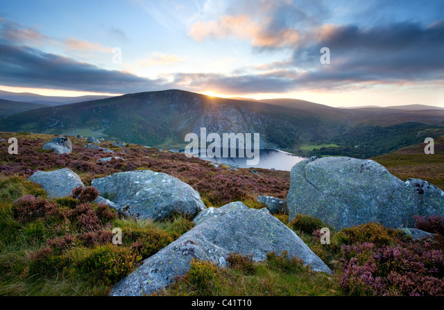 Sunset over Lough Tay, Wicklow Mountains, County Wicklow, Ireland. - Stock Image