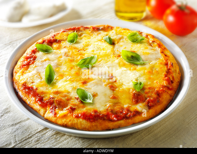 pizza Italian authentic traditional thin crust topped margarita - Stock Image