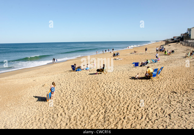 Families Relax and Sun at Kitty Hawk Beach on the Outer Banks of North Carolina - Stock Image