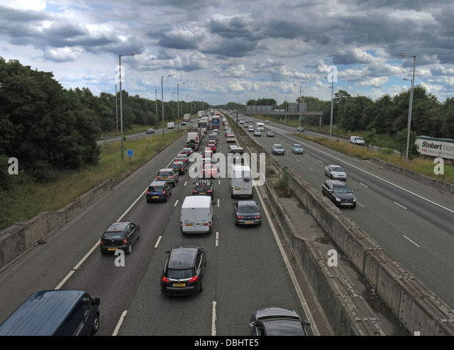 Friday traffic jam M6 Southbound Knutsford with cloudy sky J19 - Stock Image