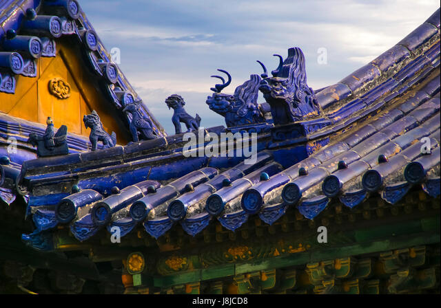 Cobalt blue tile roof with ornamentation on a building near the Temple of Heaven. Beijing, China, Asia - Stock Image