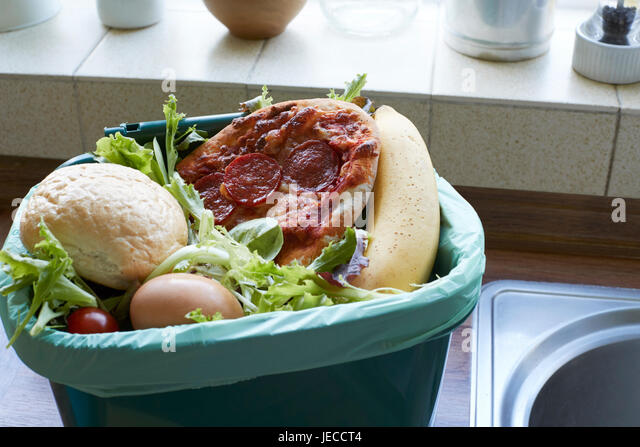 Fresh Food Waste In Recycling Bin At Home - Stock Image