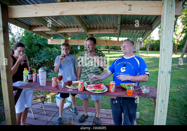 Family enjoying a good time in the Key West backyard bar. Clitherall Minnesota MN USA - Stock Image
