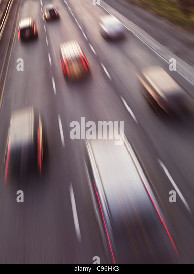 Highway traffic in motion. Dynamic high angle view photo. - Stock Image