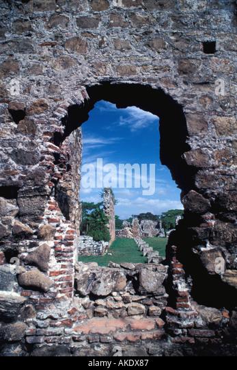 Republic of Panama old city Casco Viejo view through a brick stone doorway onto a plaza - Stock Image